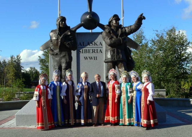 Sculptor R.T. Wallen with Russian folk dancers at the dedication of the Alaska-Siberia WWII monument, Fairbanks, Alaska